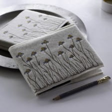 Embroidered daisies notebook